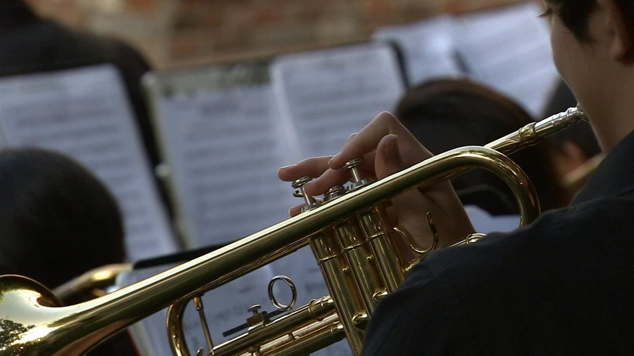 A member of the Foshay Learning Center jazz band plays a trumpet during a performance in Beverly Hills on Thursday, March 19, 2015.