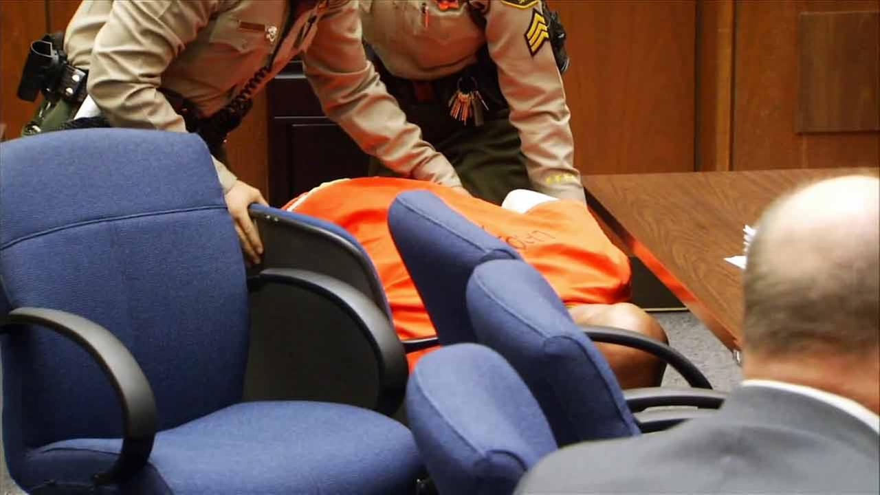 Marion Suge Knight is shown slumped over in his chair in court after a judge set bail at $25 million on Friday, March 20, 2015.