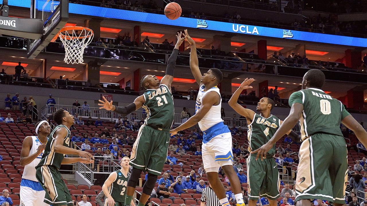 UABs Tosin Mehinti (21) attempts to block the shot of UCLAs Tony Parker during the first half of an NCAA tournament college basketball game in Louisville, Ky., Saturday, March 21, 2015.