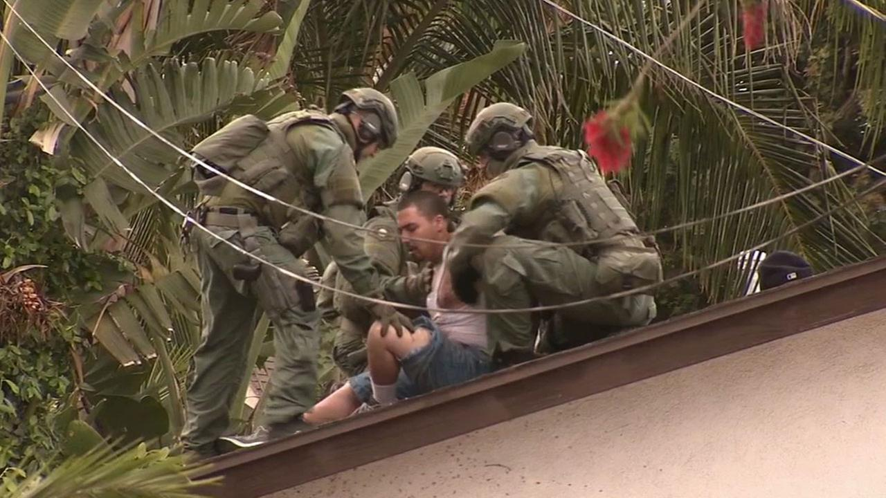 A man was taken into custody following an hours-long standoff on the roof of a home in the 1500 block of West Chanticleer Road in Anaheim Sunday, March 22, 2015.
