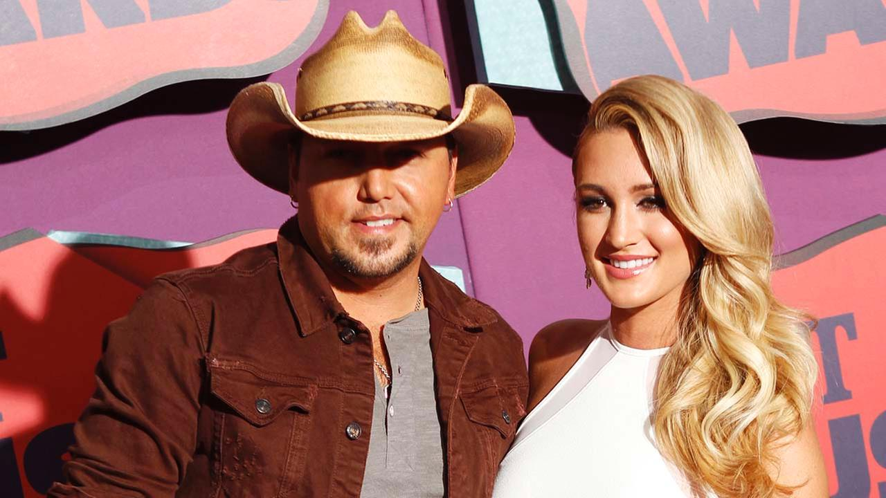 In this June 4, 2014 file photo, country singer Jason Aldean, left, and Brittany Kerr arrive at the CMT Music Awards in Nashville, TN.