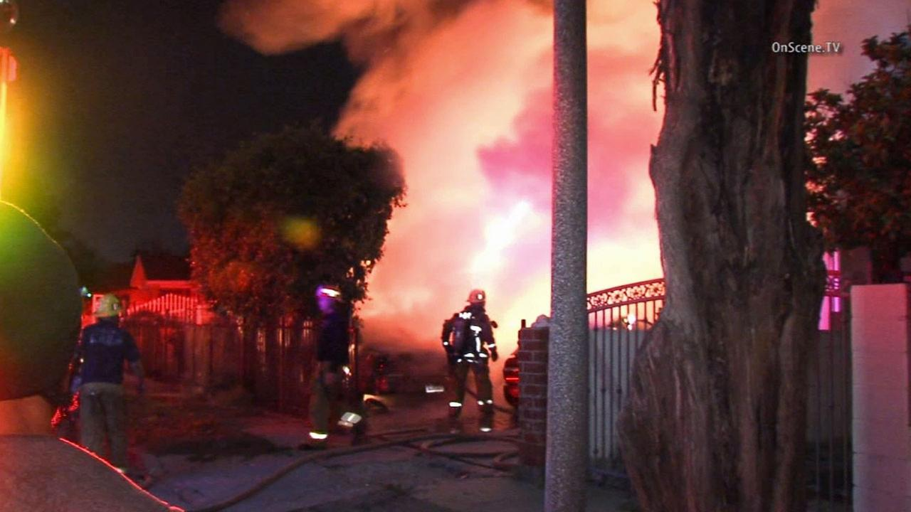 Firefighters respond to the scene of a fire in the 400 block of E. 107th Street in South Los Angeles Sunday, March 22, 2015.