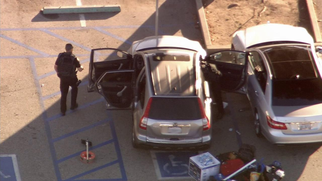 An LAPD bomb squad inspects a suspicious package inside a vehicle in Westwood Village on Wednesday, March 25, 2015.