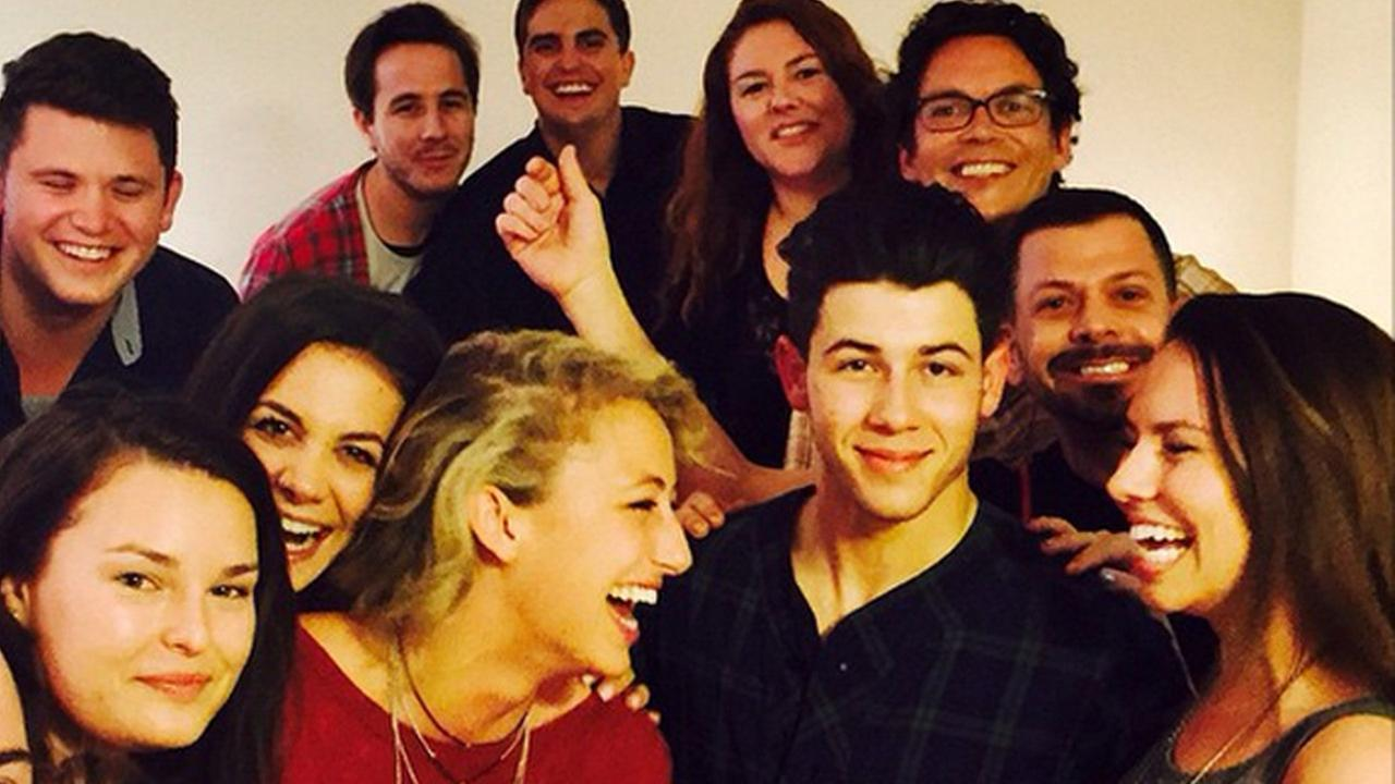 Nick Jonas poses for a photo with some lucky fans on Saturday, March 28, 2015.