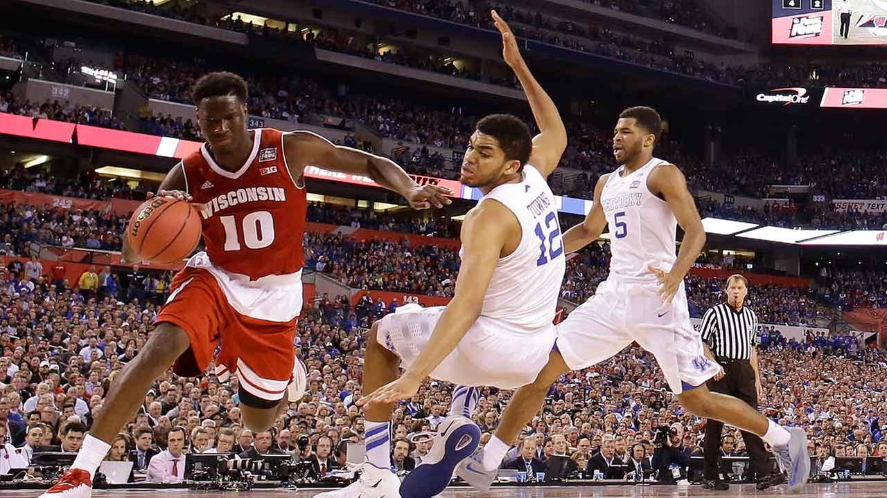 Wisconsins Nigel Hayes (10) drives against Kentuckys Karl-Anthony Towns (12) during the second half of the NCAA Final Four tournament college basketball semifinal game Saturday, April 4, 2015, in Indianapolis.