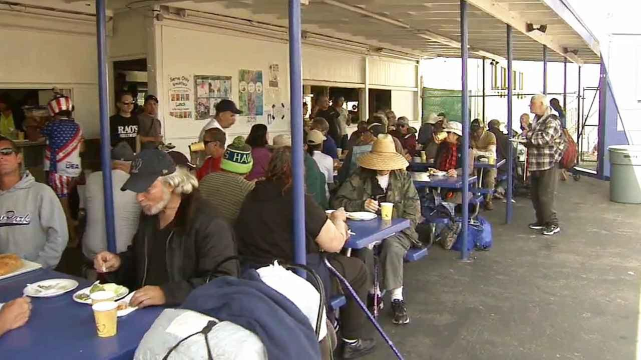 A man who goes by the moniker Robin Hood hosted a free dinner for the needy and less fortunate at St. Anne Catholic Church and Shrine in Santa Monica Sunday, April 5, 2015.