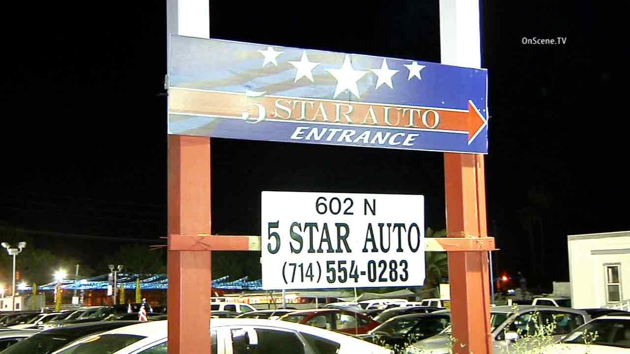 A security guard at a used car lot in Santa Ana was stabbed and beaten on Thursday, April 9, 2015.