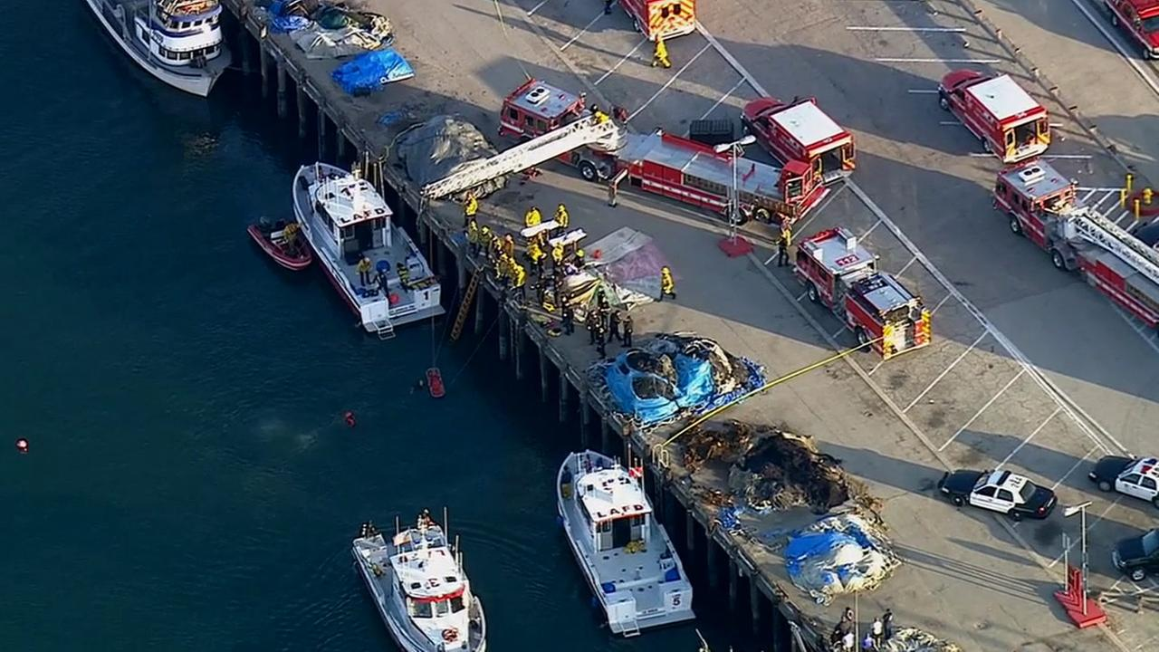 Rescue divers pulled four people out after their car plunged in 30-foot-deep water at Berth 73 at the Port of Los Angeles Thursday, April 9, 2015.