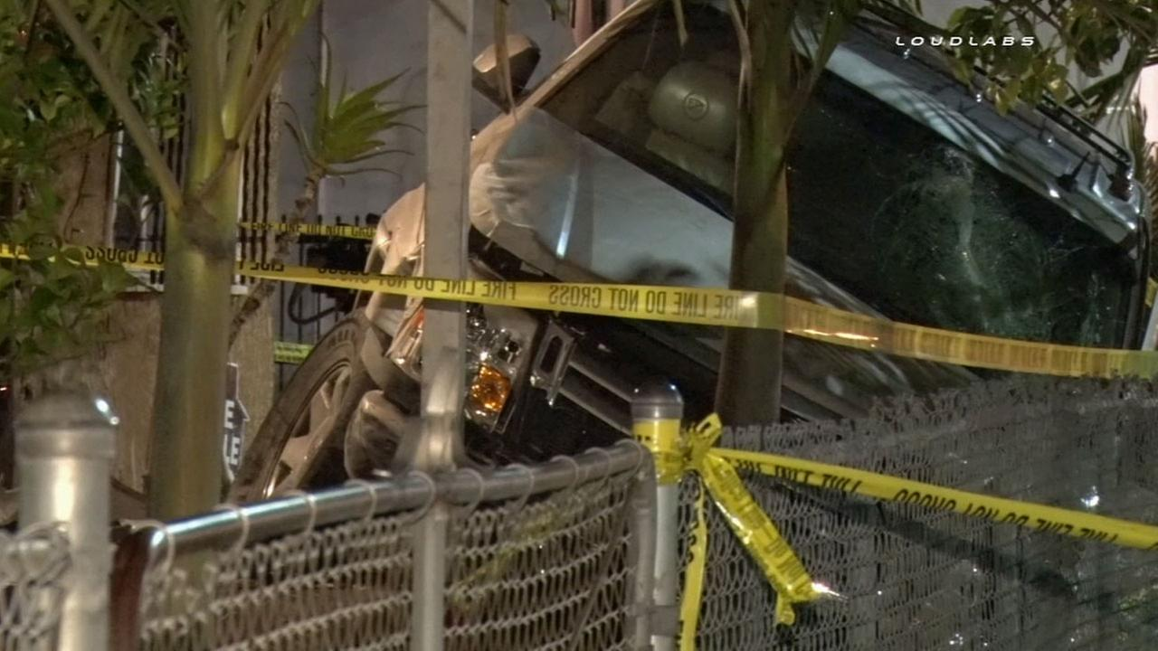 The driver of an SUV crashed into a home in South Los Angeles after striking two pedestrians on Friday, April 10, 2015.