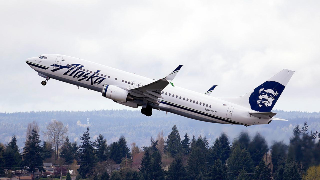 In this photo taken Tuesday, March 24, 2015, an Alaska Airlines jet takes off at Seattle-Tacoma International Airport in SeaTac, Wash.