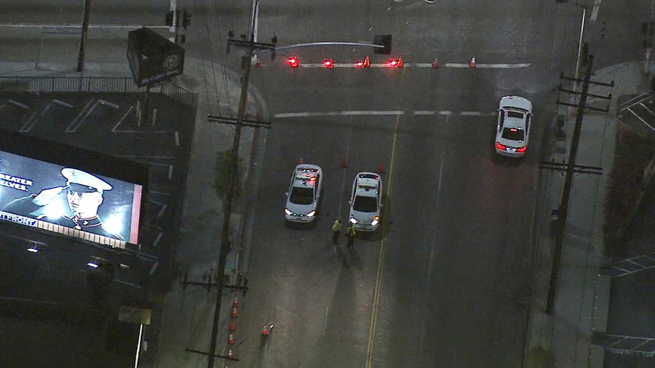 LAPD officers block traffic near 3rd Street and Orlando Avenue due to a suspicious package Tuesday, April 14, 2015.