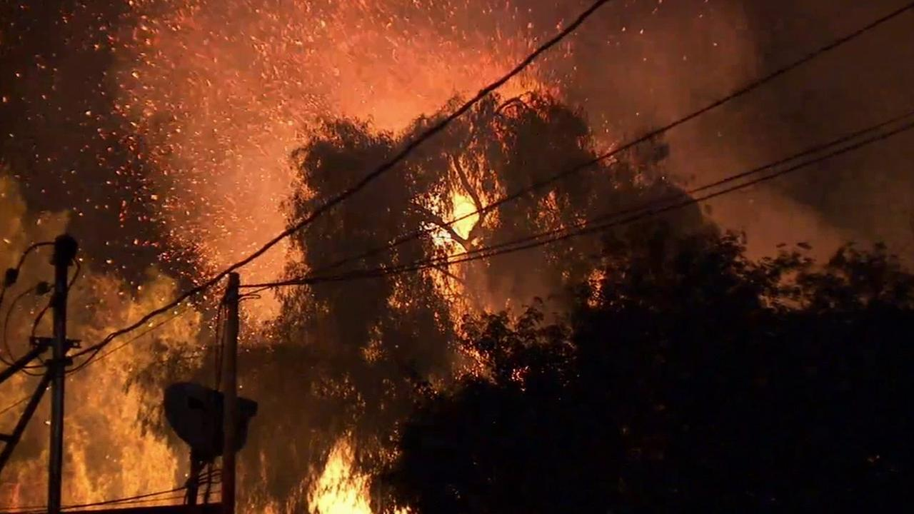 Flames burned dangerously close to El Monte homes on Wednesday, April 15, 2015.