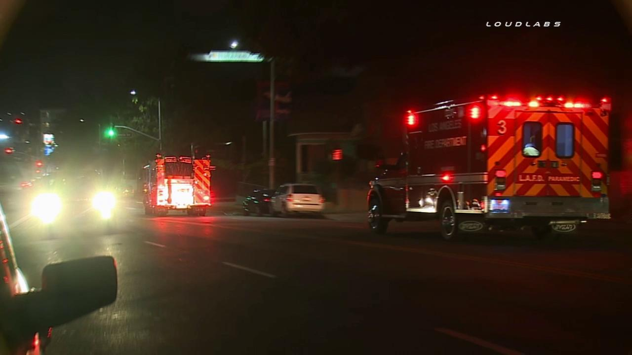 Paramedics rush an 18-year-old woman to an area hospital after she was struck by a hit-and-run driver in Echo Park on Wednesday, April 15, 2015.