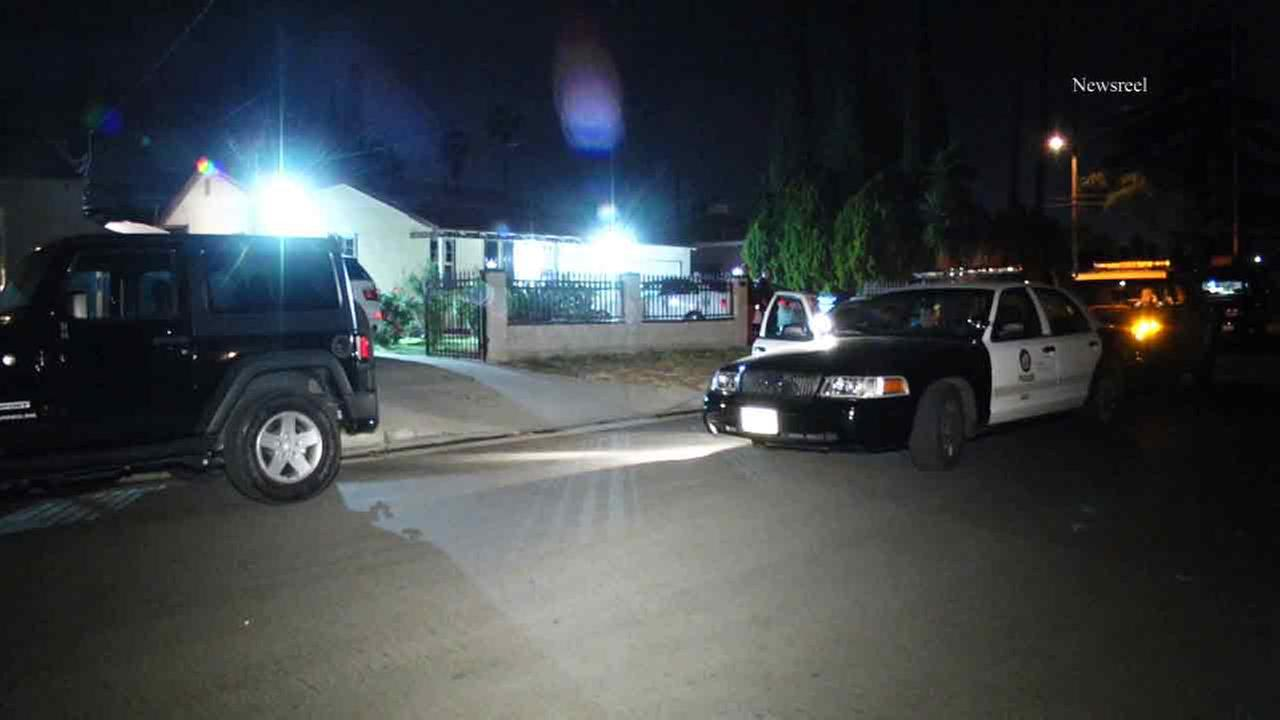 A police cruiser is shown parked outside of a residence involved in a home invasion robbery in North Hollywood on Thursday, April 16, 2015.