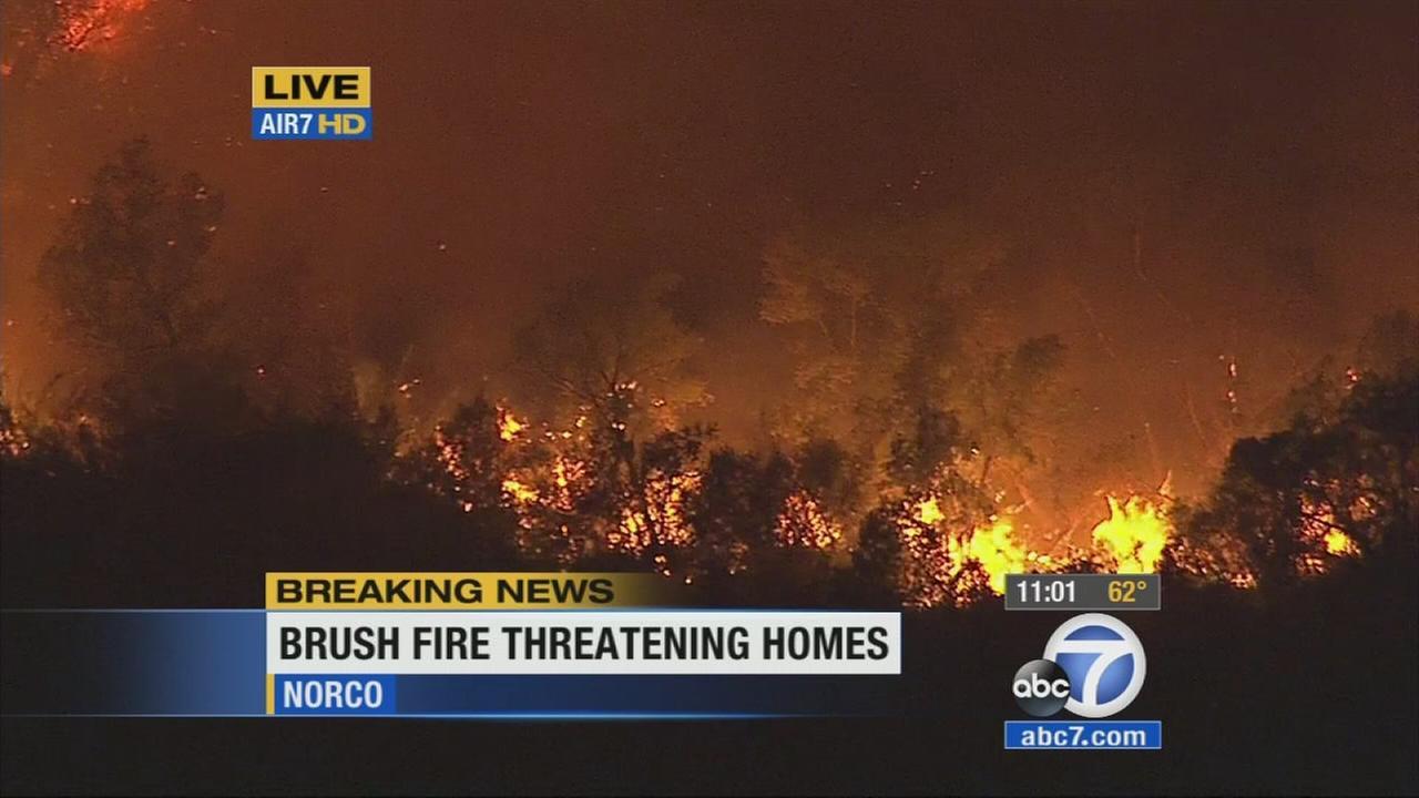 A fire erupted near the Prado Dam in San Bernardino County Saturday, April 18, 2015.