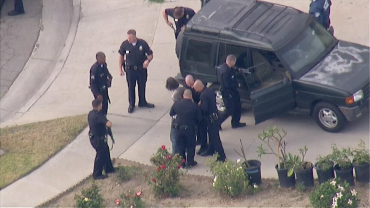 A narcotics suspect was taken into custody near Pico Vista and Telegraph roads in Downey following an hours-long standoff Tuesday, April 21, 2015.