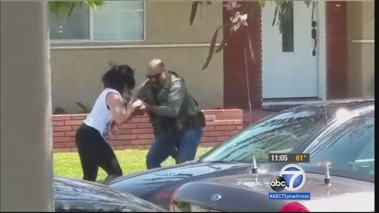 South Gate neighbors are raising questions about a deputy U.S. marshal seen seizing the cellphone of a resident, smashing the device then kicking it away.