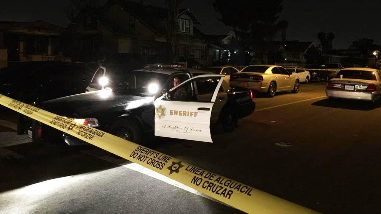 Crime scene tape ropes off the scene of a fatal double shooting in South Los Angeles on Thursday, April 23, 2015.