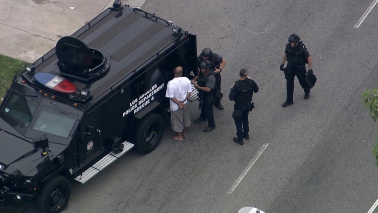 An alleged gunman surrendered to police following an hours-long barricade at an apartment complex in the 15900 block of Sherman Way in Van Nuys Friday, April 24, 2015 .