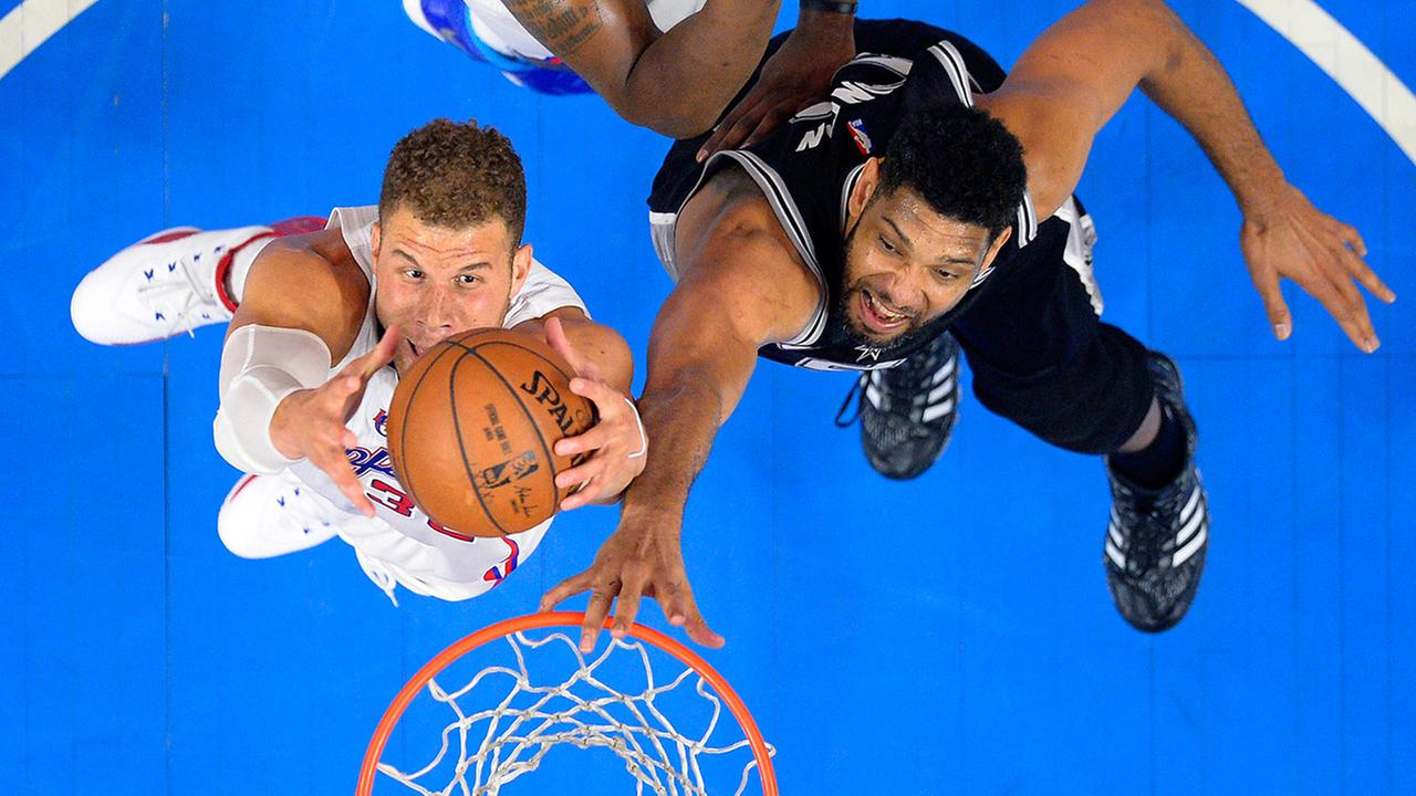 Los Angeles Clippers forward Blake Griffin, left, grabs a rebound away from San Antonio Spurs forward Tim Duncan during the first half of Game 5 of a first-round NBA basketball playoff series, Tuesday, April 28, 2015, in Los Angeles.