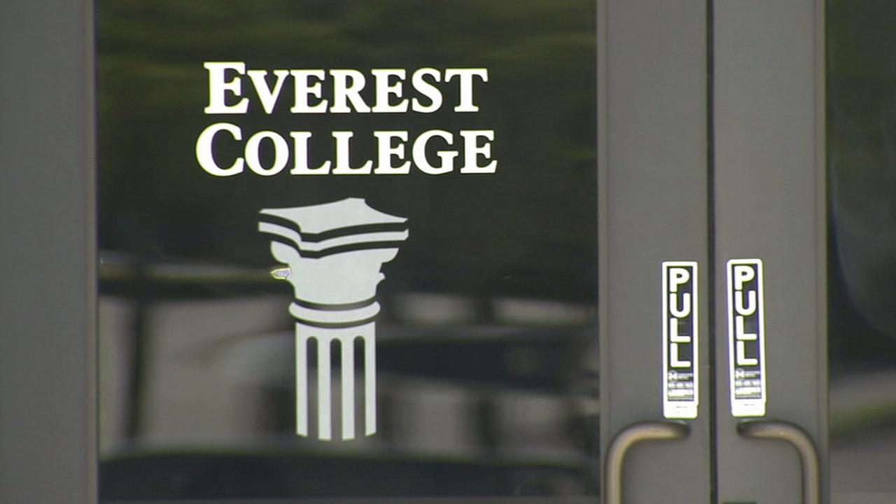 The logo of Everest College is shown on a door in this undated photo,