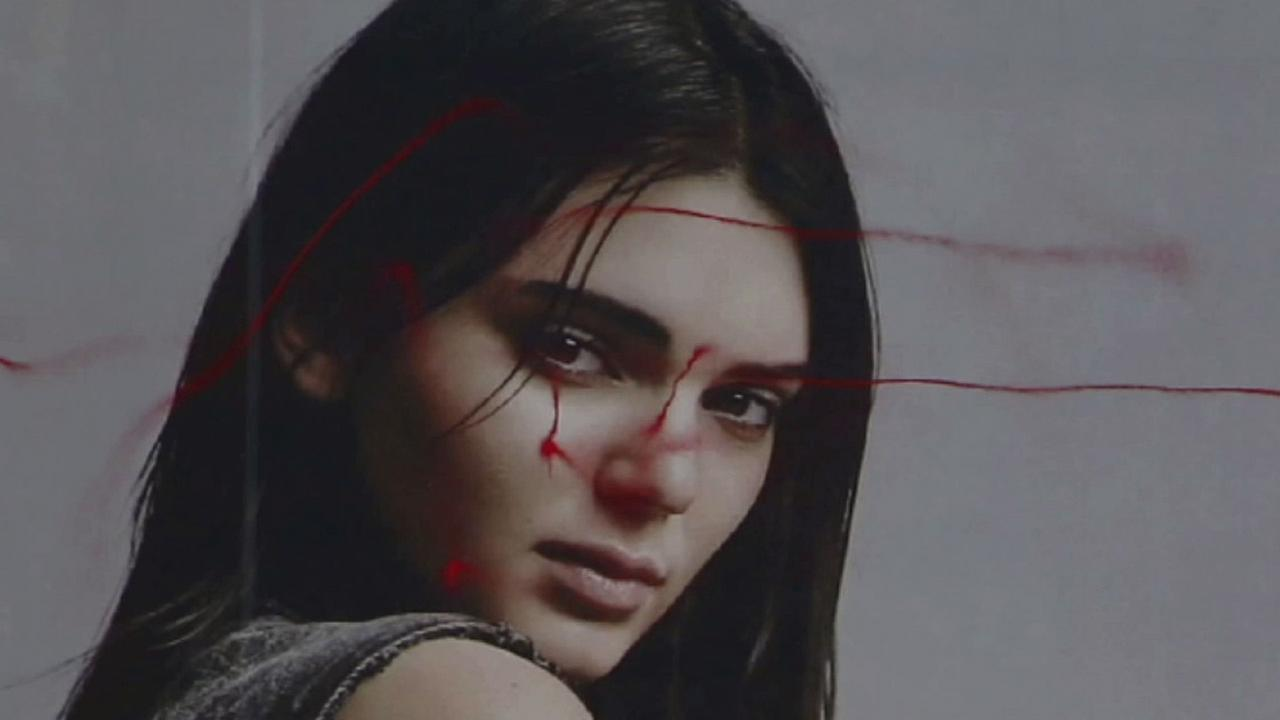 A drone was used by multimedia artist Katsu to deface a Calvin Klein billboard featuring Kendall Jenner in New York City.