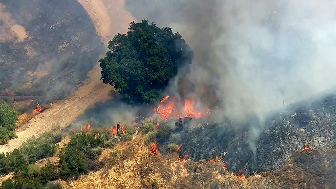 A  brush fire erupted along the 14 Freeway near the 5 Freeway interchange in the Newhall Pass area on Monday, May 4, 2015.