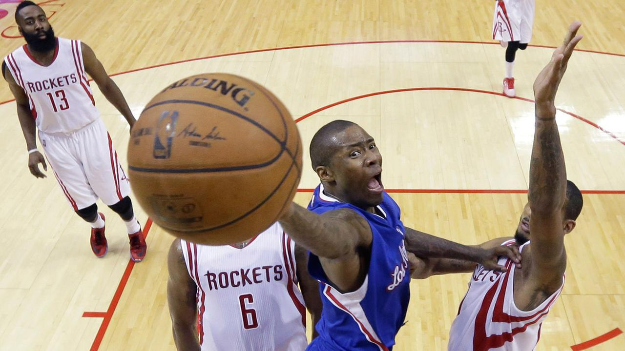 Los Angeles Clippers Jamal Crawford drives to the basket between Houston Rockets defenders Terrence Jones and Trevor Ariza during second-round NBA playoff series on May 6, 2015.