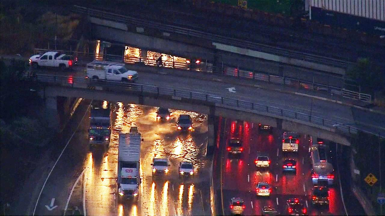 A clogged storm drain was to blame for flooding on the northbound 4 Freeway at Atlantic Boulevard in Commerce on Friday, May 8, 2015.