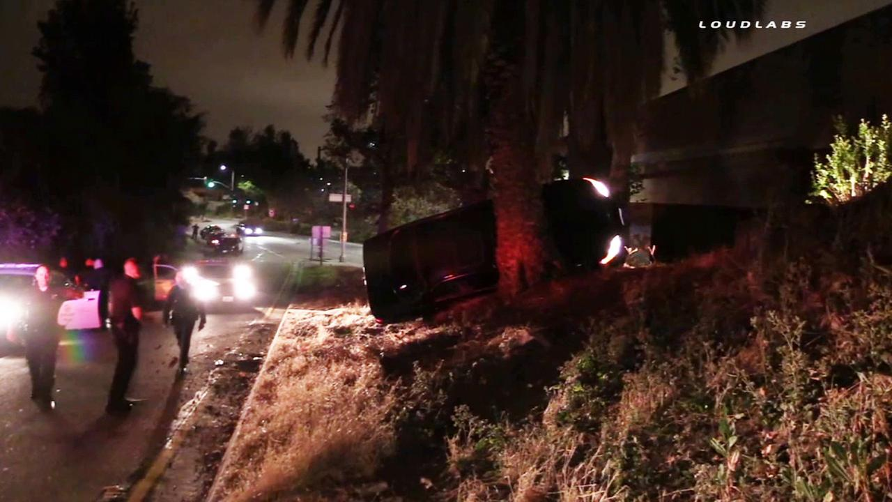 A suspect lost control of a stolen car and flipped over near the 101 Freeway on-ramp during a high-speed chase in Silver Lake Sunday, May 17, 2015.