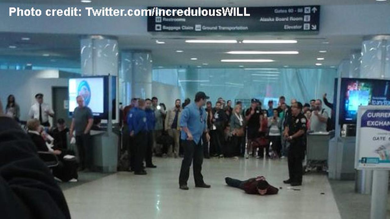 A man is taken into custody at LAX Terminal 6 on Wednesday, May 20, 2015.