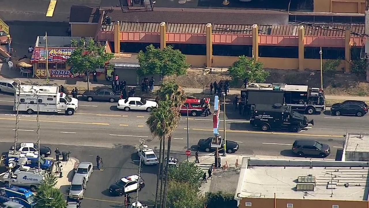 Los Angeles police respond to a barricade situation in the 200 block of North Kenmore Avenue Tuesday, May 26, 2015.