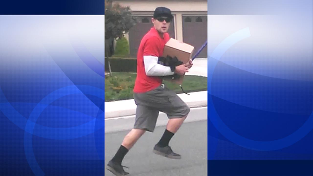 A man believed to have stolen a box from a car parked in Murrieta is shown on Wednesday, May 20, 2015.