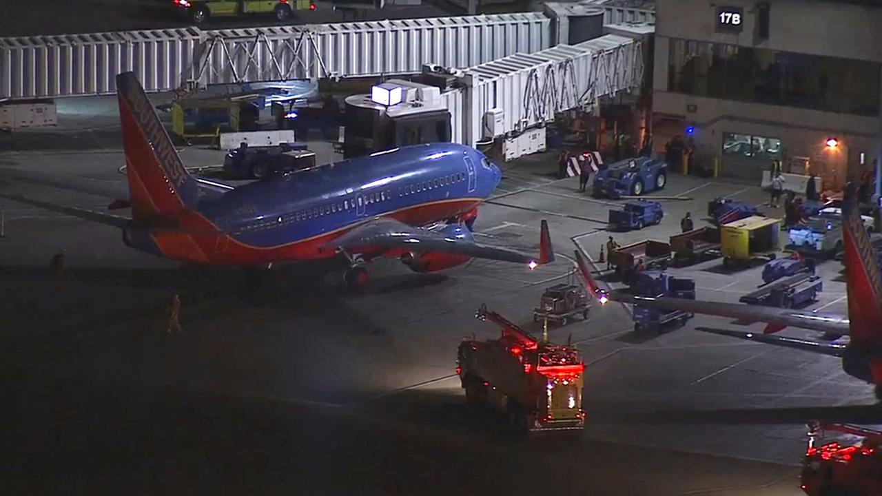A Southwest Airline plane makes an emergency landing at Los Angeles International Airport on Tuesday, May 26, 2015.