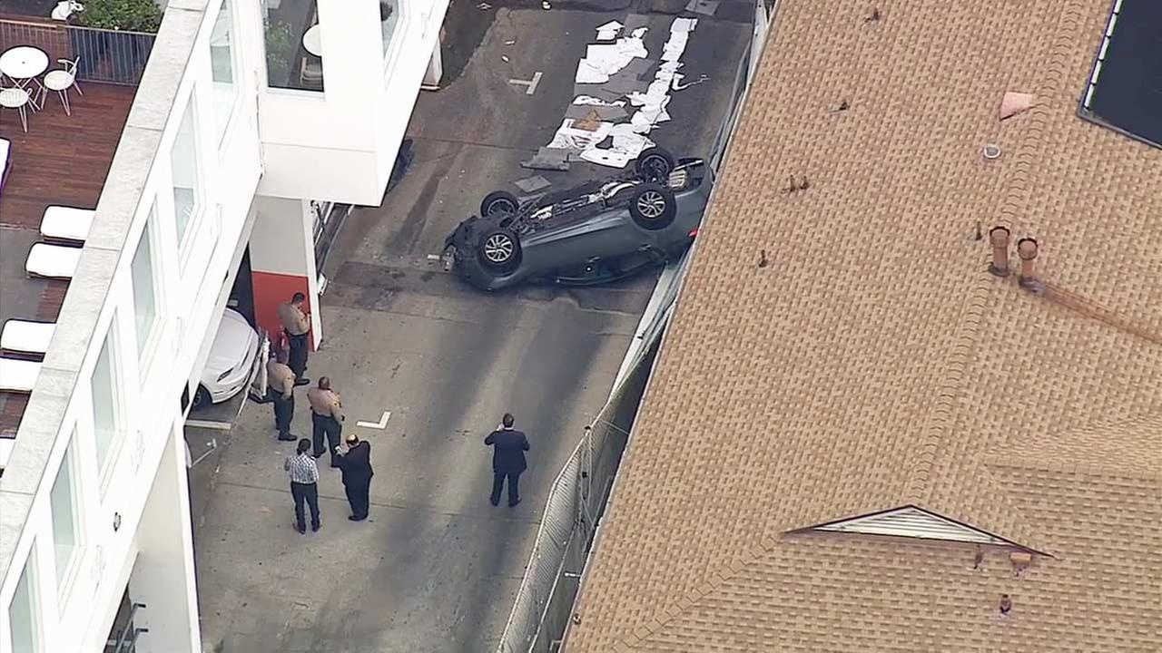A car landed upside down after falling off a parking structure at the Mondrian LA Hotel in West Hollywood on Wednesday, May 27, 2015.