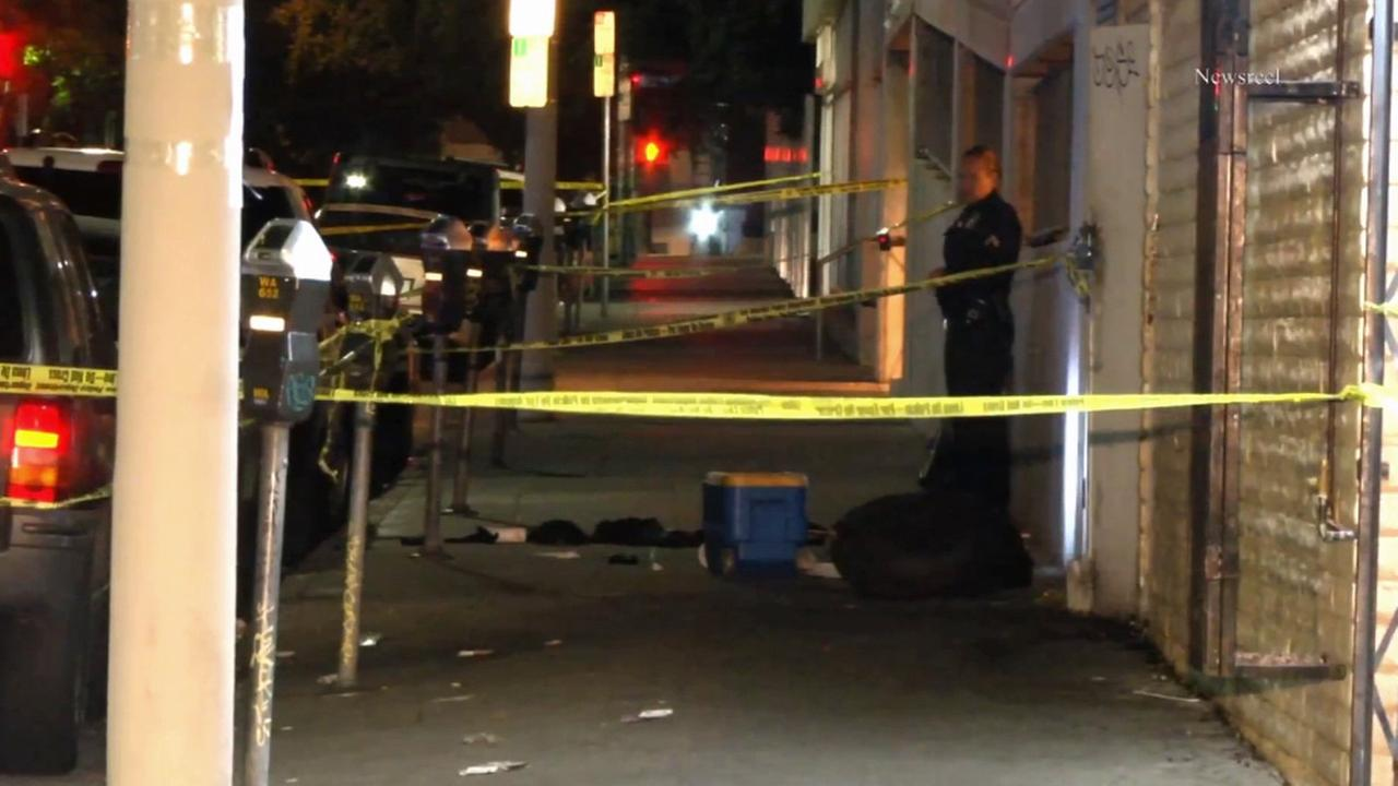Crime scene tape ropes off the scene of an officer-involved shooting in the 600 block of Coronado Street in Los Angeles Westlake District.
