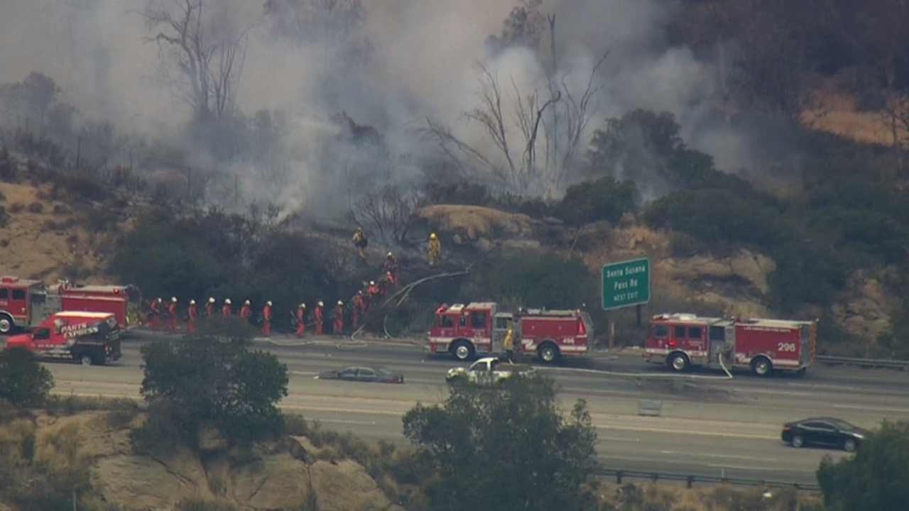 Los Angeles and Ventura county firefighters respond to a fast-moving brush fire along the 118 Freeway at Topanga Canyon Boulevard Thursday, June 4, 2015.