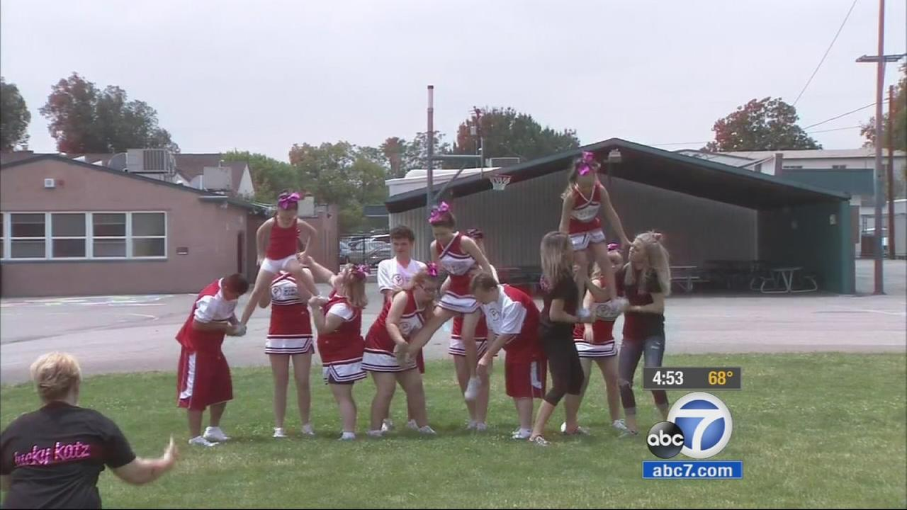 A competitive cheerleading team made up of members with special needs paid a visit to a San Bernardino school Thursday, about a month before heading to the Special Olympics World Games in Los Angeles in July.
