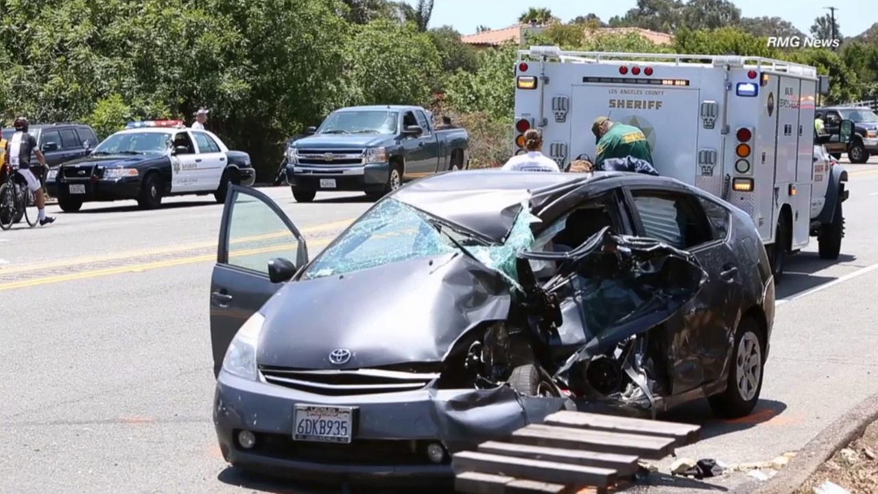 Los Angeles County sheriffs deputies investigate a crash along Pacific Coast Highway in Malibu on Saturday, June 6, 2015.