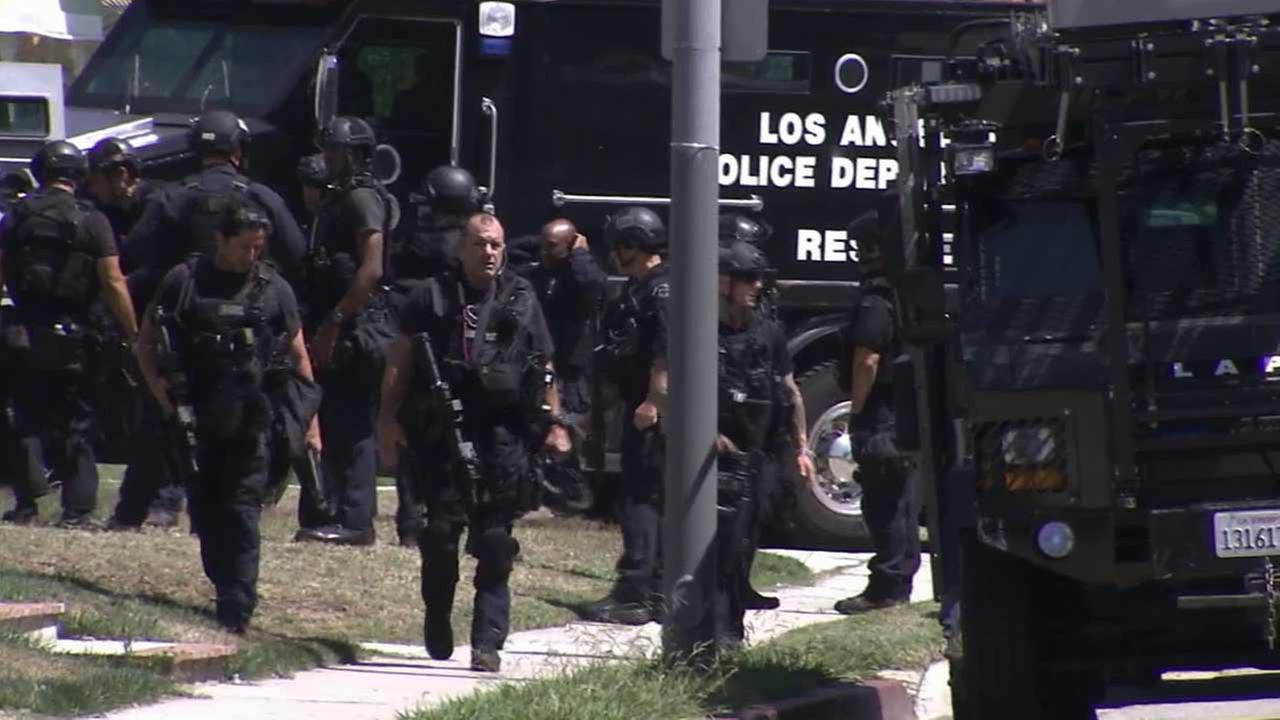 A SWAT team responds to a barricade situation in the 3800 block of Arlington Avenue in Leimert Park Sunday, June 7, 2015.