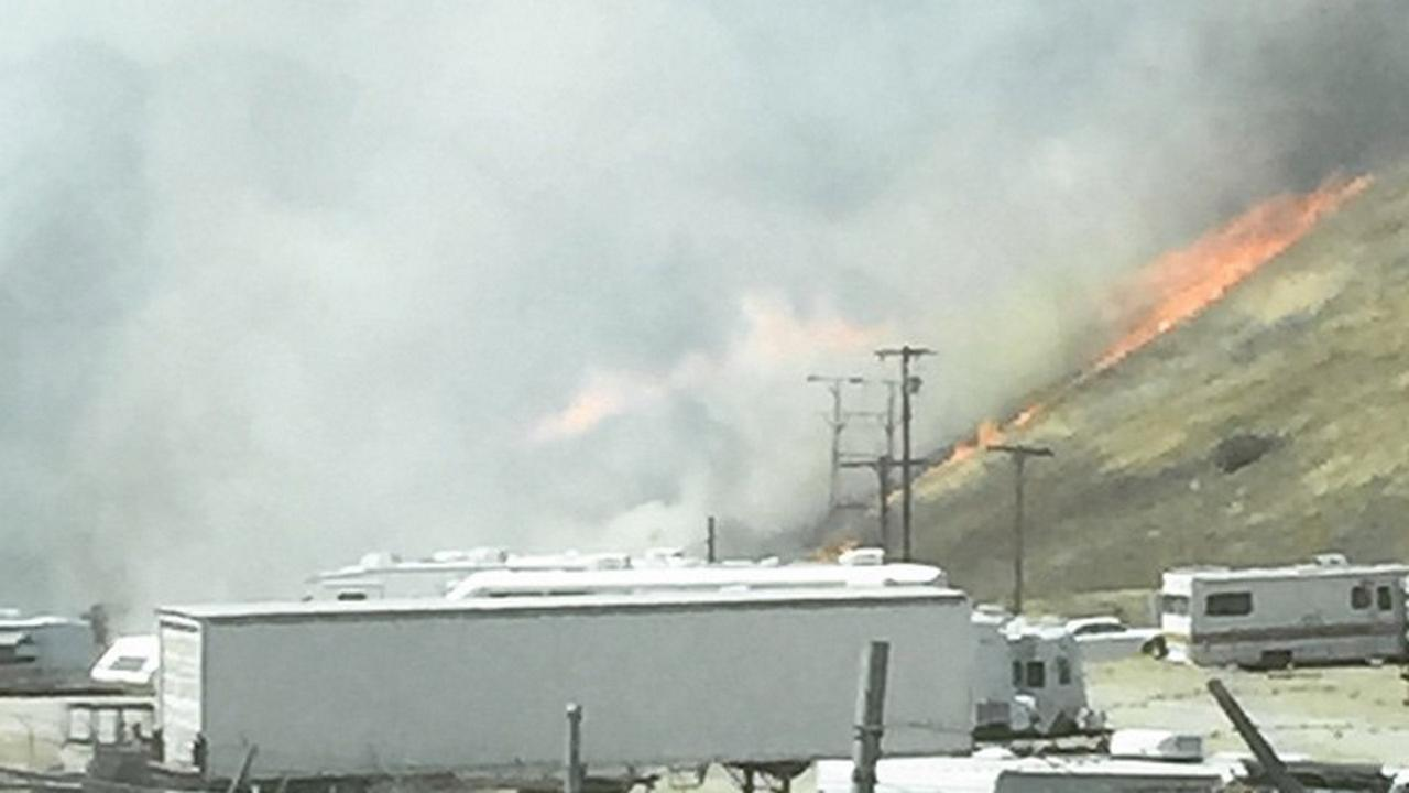 An ABC7 viewer submitted this photo of the flames spreading on the side of a hill in Castaic near N. Lake Hughes Road on Saturday, June 13, 2015.
