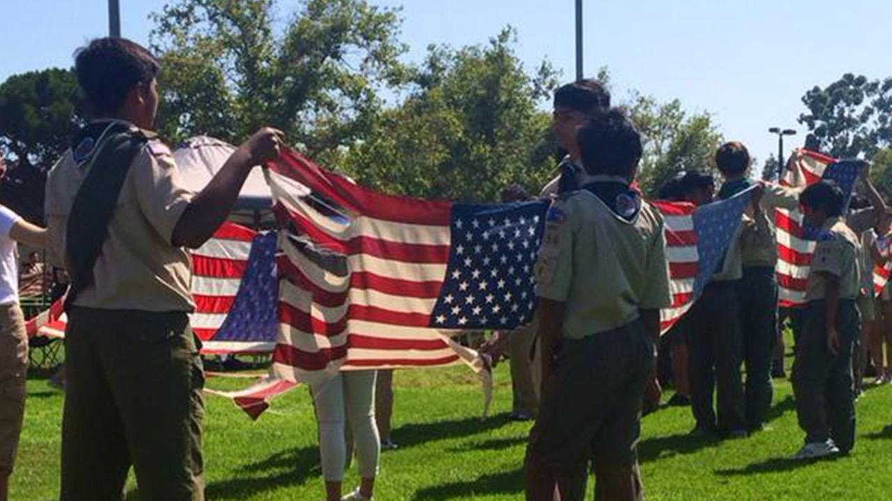 Boy Scouts give old flags a proper retirement in a ceremony held in Cerritos on Sunday, June 14, 2015.