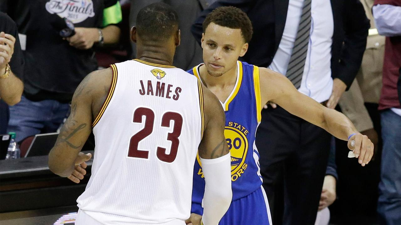 Cleveland Cavaliers forward LeBron James congratulates Golden State Warriors guard Stephen Curry during Game 6 of basketballs NBA Finals in Cleveland, Tuesday, June 16, 2015.