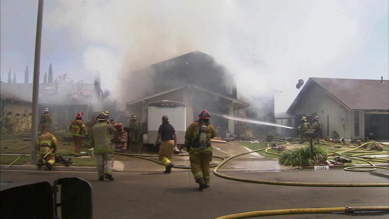 Firefighters battle a house fire in Yorba Linda on Wednesday, June 17, 2015.