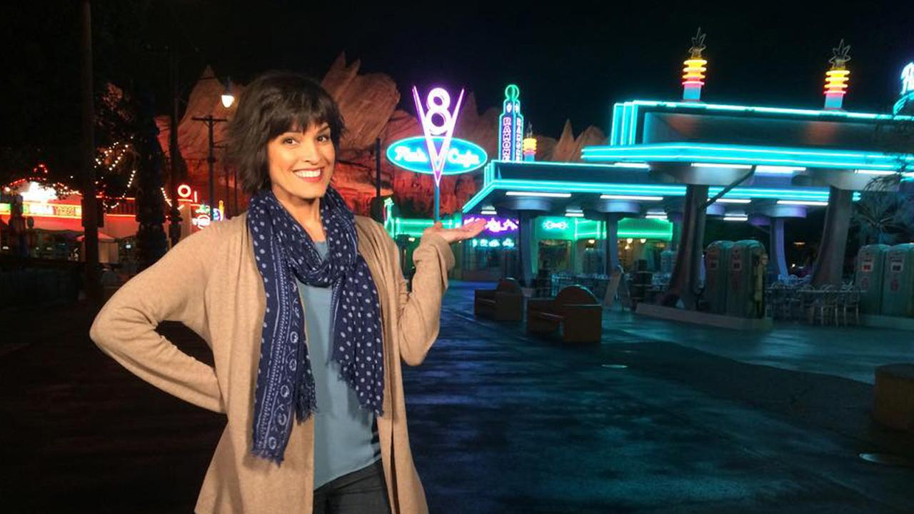 Tina Malave poses for a photo at Cars Land inside Disneyland California Adventure.