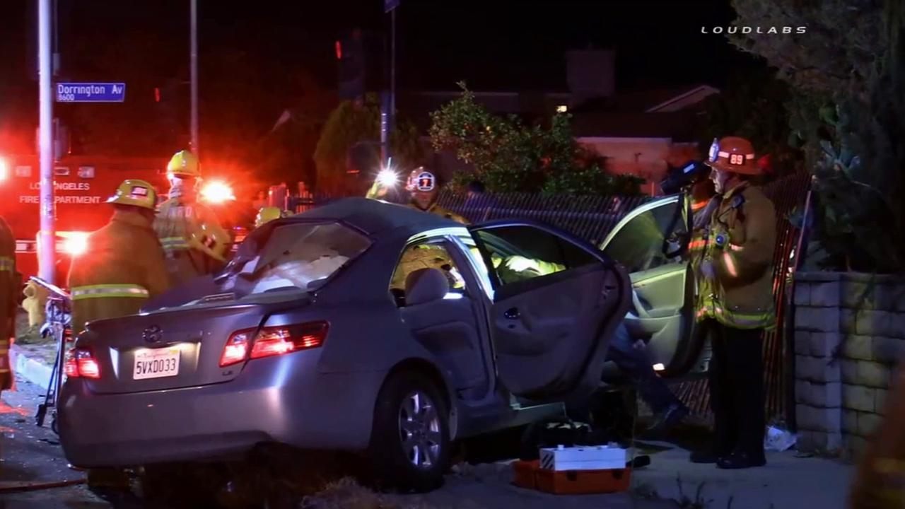 Los Angeles firefighters attempt to rescue the victims of a deadly crash in Arleta on Saturday, June 20, 2015.