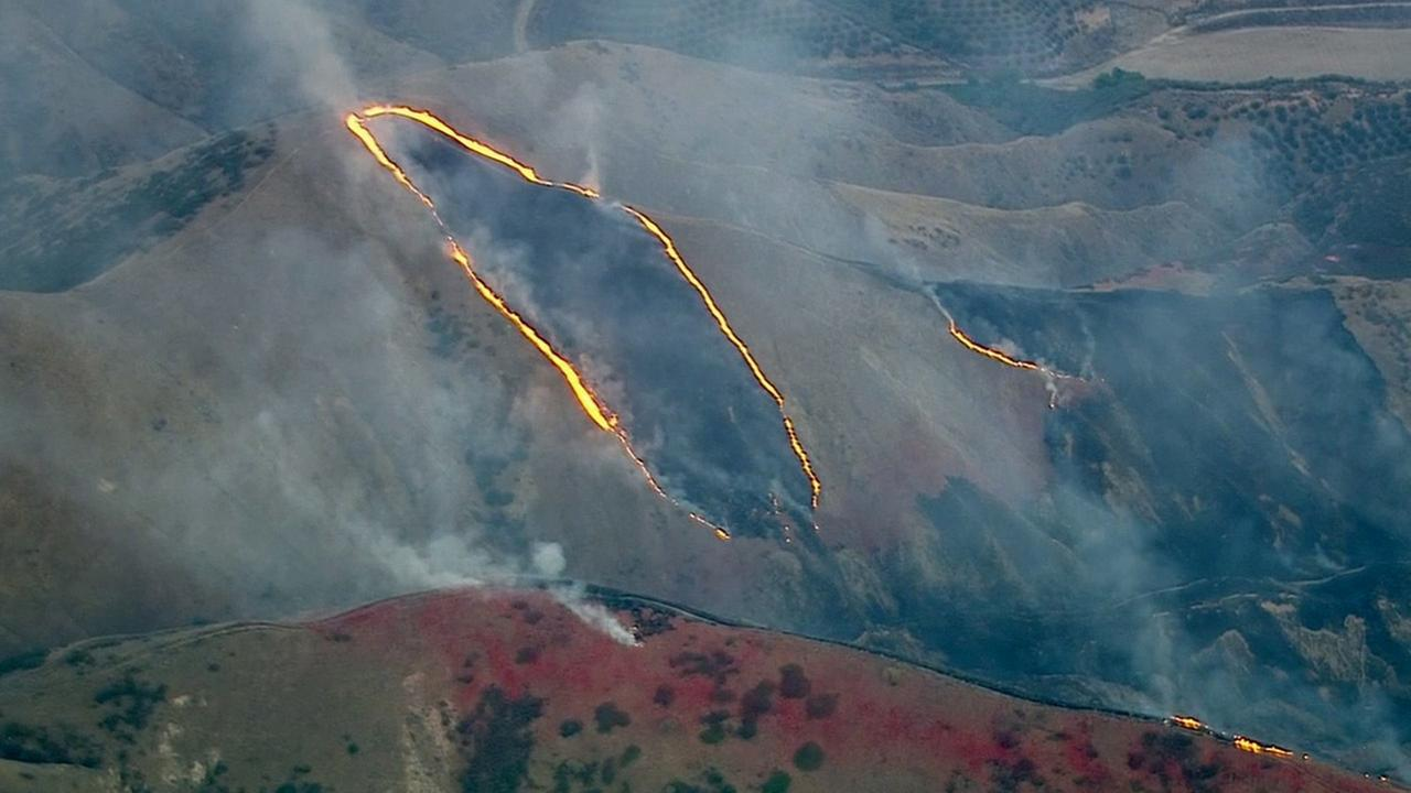 The outline of the Sterling Fire, a brush fire that broke out in the San Bernardino foothills, is captured by AIR7 HD on Thursday, June 25, 2015.