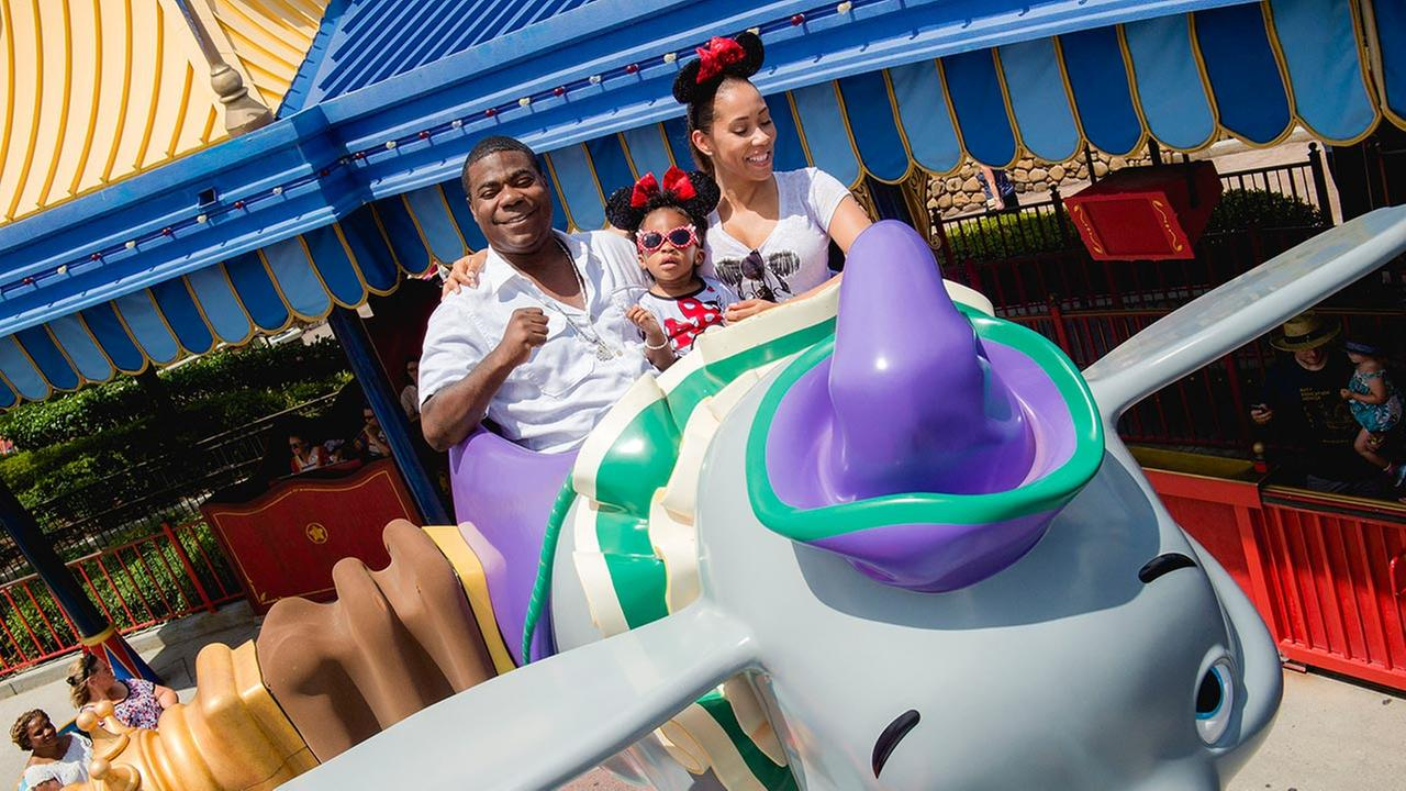 Tracy Morgan, fiancee Megan Wollover and daughter Maven Morgan, 2, take flight July 2, 2015, on Dumbo The Flying Elephant at the Magic Kingdom theme park.