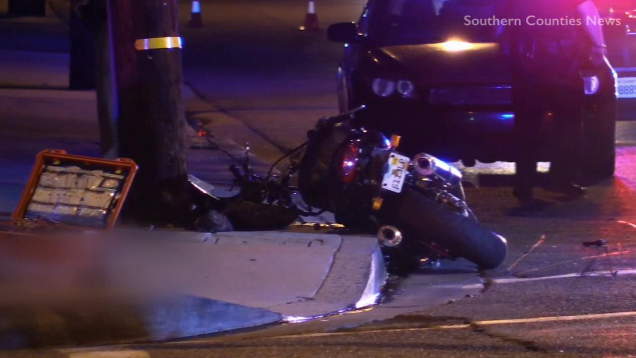 A motorcycle lays dismantled on the curb at the intersection of Katella Avenue and Batavia Street in Orange after a chase suspect crashed the bike on Friday, July 3, 2015.