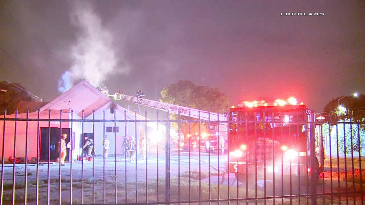Firefighters battle a church fire at San Pedro Street and Manchester Avenue in South Los Angeles on Thursday, July 9, 2015.